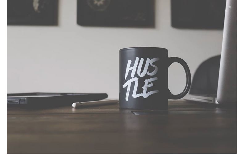 A mug labeled 'Hustle' depicting the entrepreneurial spirit