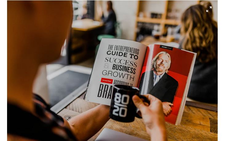 A man reading an article on entrepreneurship