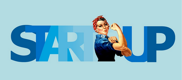 A lady holding her hand up and fist folded indicating business growth for startups